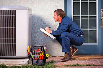 Technician performing annual HVAC maintenance