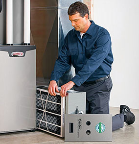 An HVAC technician servicing an air purification device.
