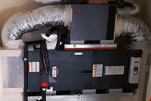 A Whole Home Dehumidifier Installed On A Trane HVAC System